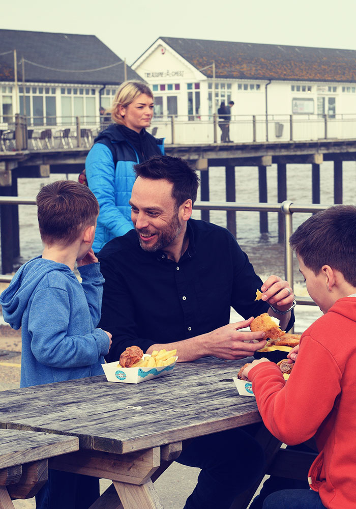 Enjoying Fish and Chips outside