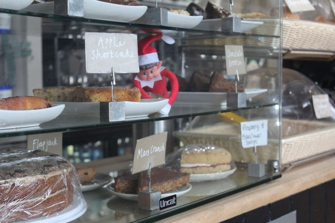 Cake and Coffee combo at the Clockhouse only £4.95!! Even Rocky the elf can't resist 🍰 ☕️⠀ #southwoldpier #southwold #suffolk