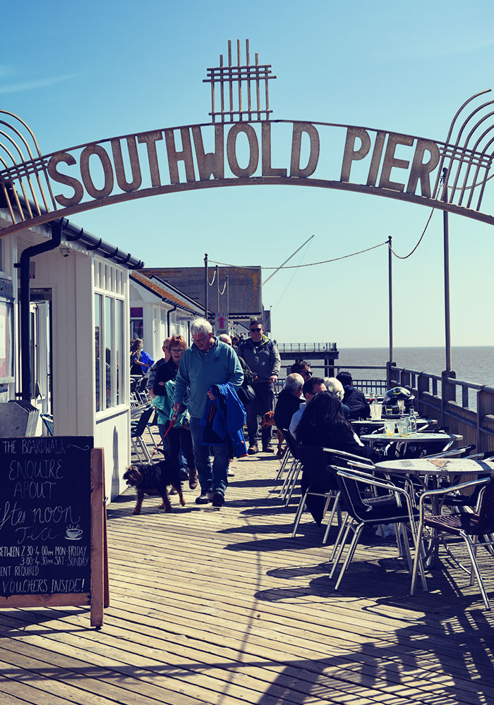Walking a dog on Southwold Pier
